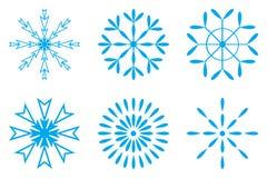 Escamas azules de la nieve fijadas Imágenes de archivo libres de regalías
