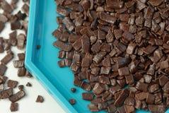 Escamas del chocolate imágenes de archivo libres de regalías
