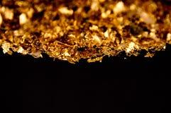 Escamas del oro imágenes de archivo libres de regalías
