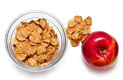 Escamas y manzana del cereal Foto de archivo