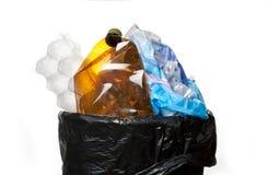 Escaninho de lixo completo fotografia de stock royalty free