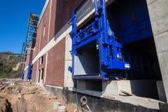 Escaninhos hidráulicos dos resíduos sólidos da construção Fotografia de Stock