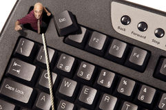Escape. Businessman escaping from Escape key in a computer keyboard stock images