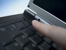 Escape. Finger about to press the escape key on a laptop. Focus on the esc. key Stock Photography