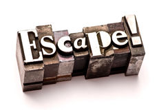 Escape. The word Escape photographed using vintage letterpress type stock photography