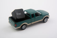 Escape!. Miniature pick up truck with escape key in bed Royalty Free Stock Photo