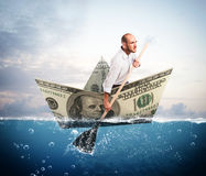 Escape on banknote boat Stock Images