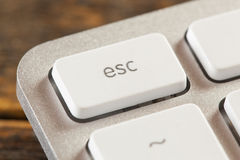 Escape Button on a White and Grey Computer Keyboard Royalty Free Stock Photo