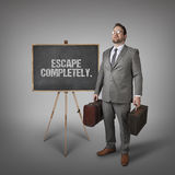 Escape completely text on blackboard with businessman Stock Photos