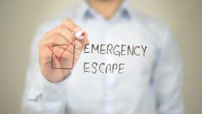 Escape da emergência, escrita do homem na tela transparente imagem de stock