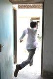 Escape do homem Foto de Stock