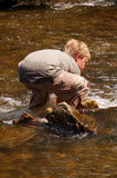 Escape from the heat. Boy cooling off in Minnehaha Creek Royalty Free Stock Photos