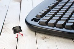Escape key run away from a black keyboard Royalty Free Stock Photo