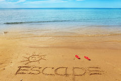 Escape message on the sand Royalty Free Stock Image