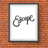 Escape Message in White Frame Hanging on the Wall Royalty Free Stock Image