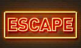 Escape neon sign on brick wall background. Royalty Free Stock Images