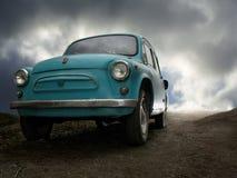 Escape of oldtimer car. Oldtimer runs through the country Stock Photos