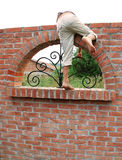 Escape over brick wall Stock Image