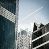 Escape. A plane flying across a business district Stock Photo