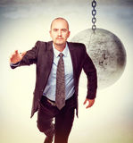 Escape from problem. 3d image of huge swinging metal ball and businessman Stock Images