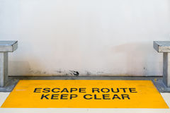 Escape route, keep clear sign blocked by concrete wall with copy space, clipping path for travel image adaptation Royalty Free Stock Photo