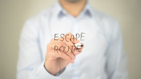 Escape Route, man writing on transparent screen royalty free stock photography