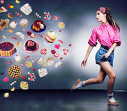 Escape. Running Woman Refuses To Eating Tasty Cake Stock Photography