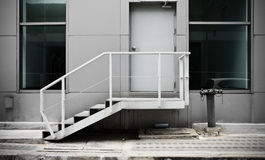 Escape stairs and door on the outside Royalty Free Stock Images