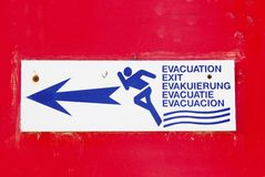 Escape to the exit sign red alert indication flee Stock Photos