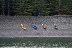 Escape to Nature. Kayaks along the shore of the Kenai Peninsula in Alaska Stock Images
