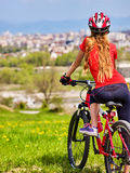 Escape urban . Bicycle girl wearing helmet rest from city urbanization. Escape urban . Bicycle girl has rest from city bustle. Woman wearing sport helmet Royalty Free Stock Photography