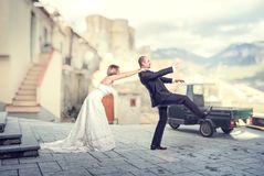Escape from wedding. Bride try to catch his groom before wedding royalty free stock images