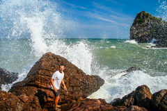 Escaping big wave. Man escaping incoming big wave on the coast in Thailand royalty free stock images