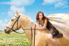 Escaping on a horseback Stock Images