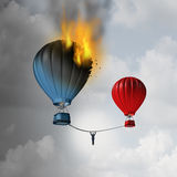 Escaping Trouble. And leaving a crisis as a businessman hanging from a rope trying to move away from a burning hot air balloon to a safer location as a business Royalty Free Stock Image