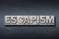 Escapism word den. Escapism word made from metallic letterpress on dark jeans background stock images