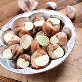 Escargots avec du beurre d'ail Image stock