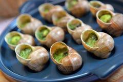 Escargots de raisin cuits au four avec du beurre Image stock