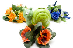 Escargots savings can in floral decoration Stock Photos