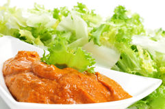 Escarole endive with romesco sauce, a typical salad from Catalon Stock Image