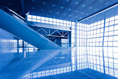 Escatator in blue hall Royalty Free Stock Images