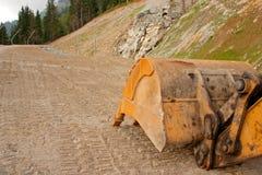 Escavador e trilha da pá Foto de Stock Royalty Free