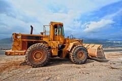 Escavador que trabalha no canteiro de obras Fotografia de Stock