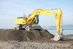 Escavadora amarela Imagem de Stock