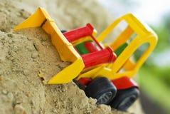 Escavadora do brinquedo Fotos de Stock Royalty Free