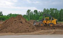 Escavadora e escavador foto de stock