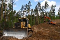 Escavadora e máquina escavadora imagens de stock royalty free