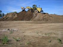 Escavadora em um poço de cascalho Fotografia de Stock Royalty Free