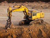 Escavadora em uma ruptura Foto de Stock Royalty Free