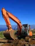Escavadora que escava um todo Fotografia de Stock